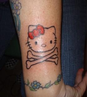 Hello kitty and bones tattoo