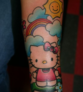 Hello kitty and rainbow tattoo