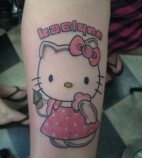Hello kitty with cupcake tattoo