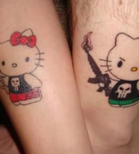 Hello kitty with guns tattoos