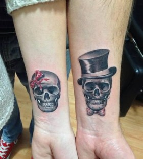 His and Hers skull couple tattoos
