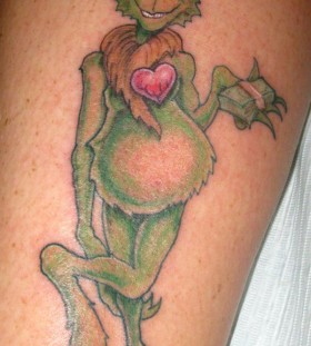 Hot looking grinch christmas tattoo
