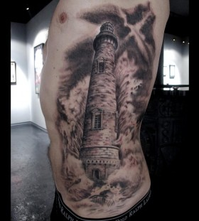 Huge lighthouse side tattoo