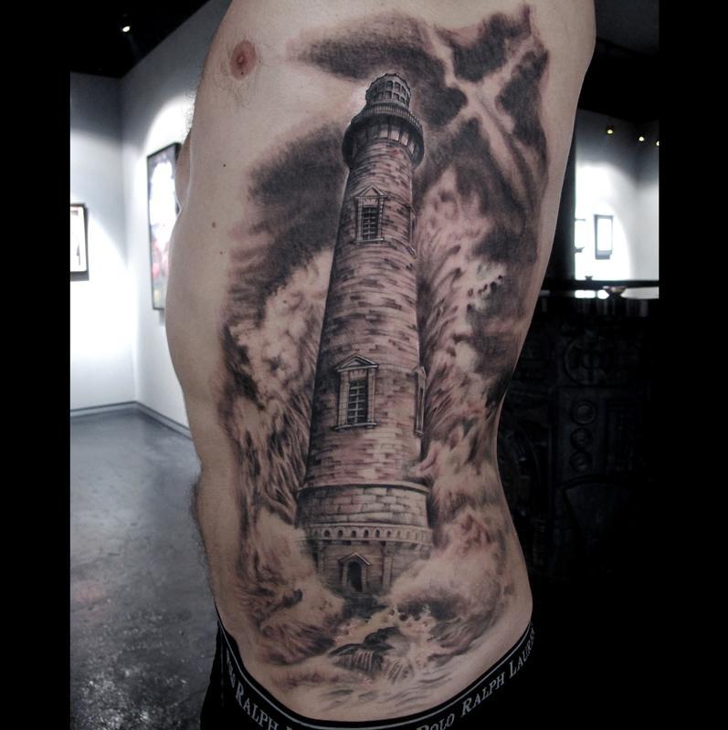 Huge lighthouse side tattoo