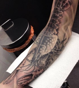 Huge lobster arm tattoo