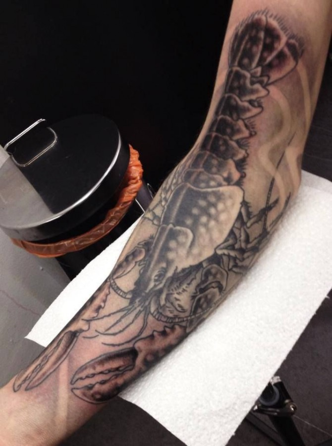 Huge lobster arm tattoo