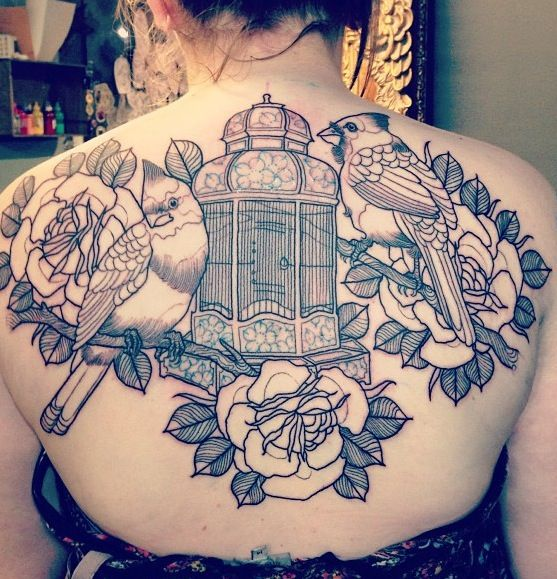 Incredible birdcage back tattoo