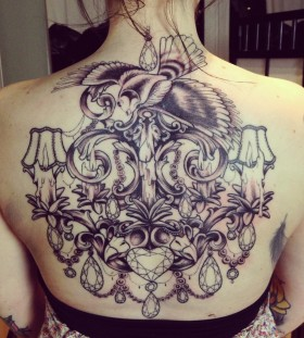 Incredible chandelier back tattoo