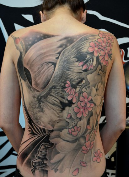 Incredible crane back tattoo