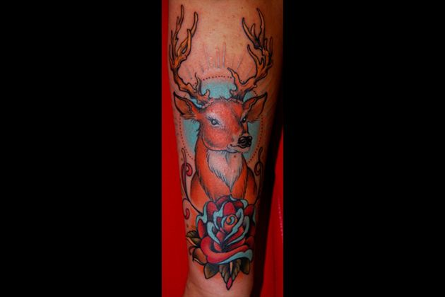 Incredible deer tattoo by W. T. Norbert