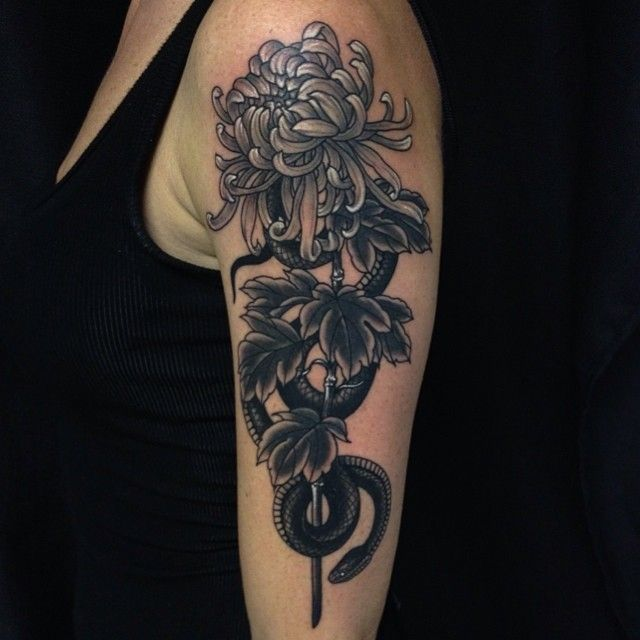 Incredible flower arm tattoo