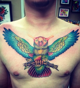 Incredible parrot chest tattoo