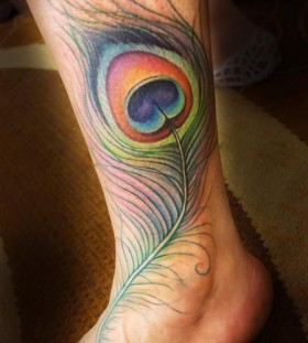 Incredible peacock feather ankle tattoo