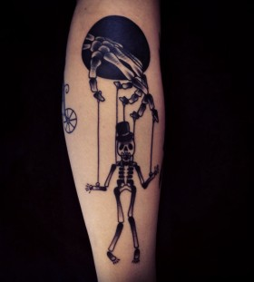 Incredible skeleton puppet tattoo