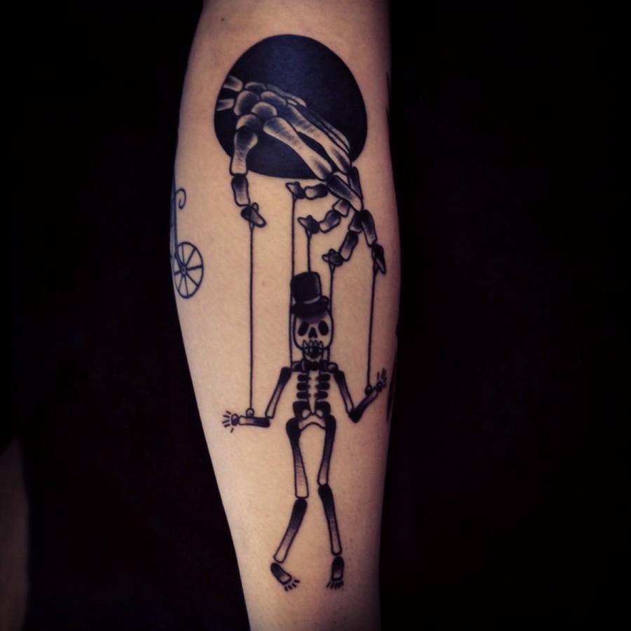 Incredible skeleton puppet tattoo
