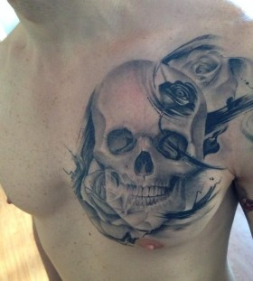 Incredible skull chest tattoo by Razvan Popescu