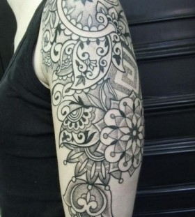Indian inspired upper arm flower tattoo