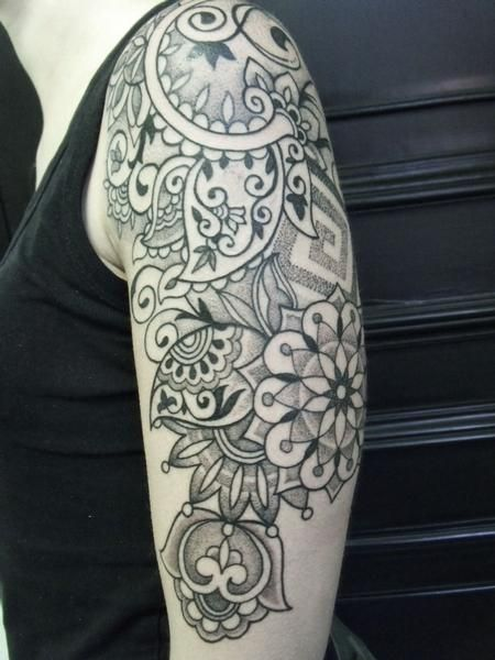 Indian inspired upper arm flower tattoo