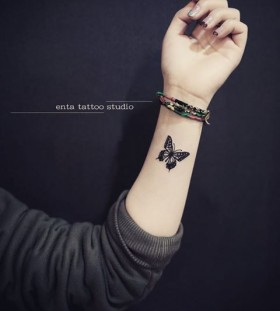 inner-arm-butterfly-tattoo-by-enta_tattoo