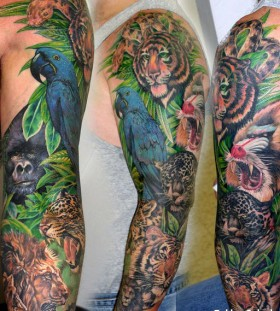 Jungle animals full arm tattoo