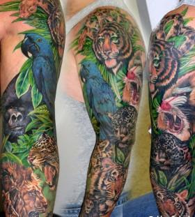 Jungle animals full arm tattoo