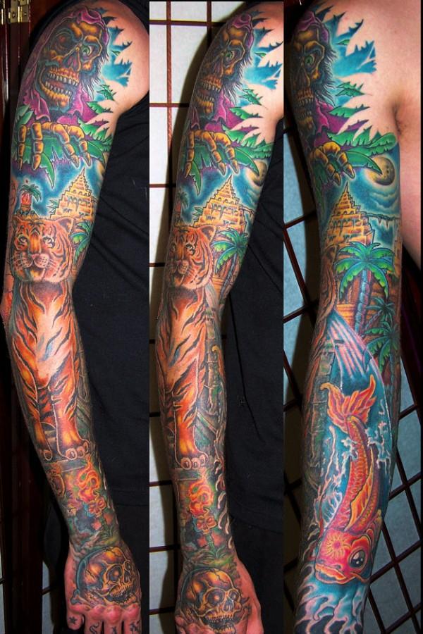 Jungle theme arm tattoo
