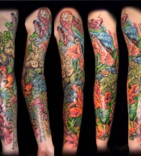Jungle theme full arm tattoo