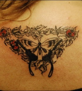 Ladybug and butterfly back tattoo