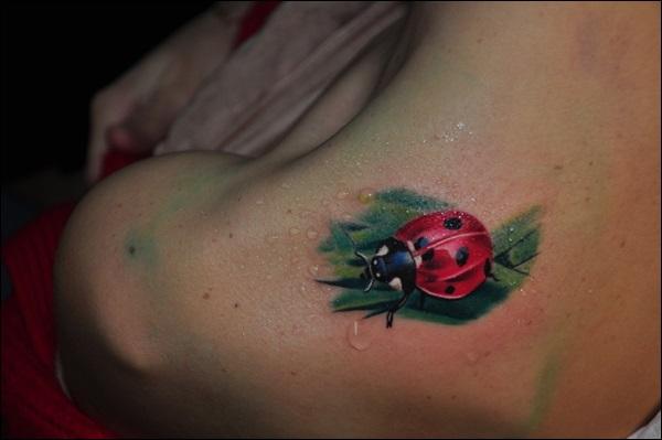 Ladybug on a leaf shoulder tattoo