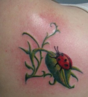 Ladybug on a leaf tattoo