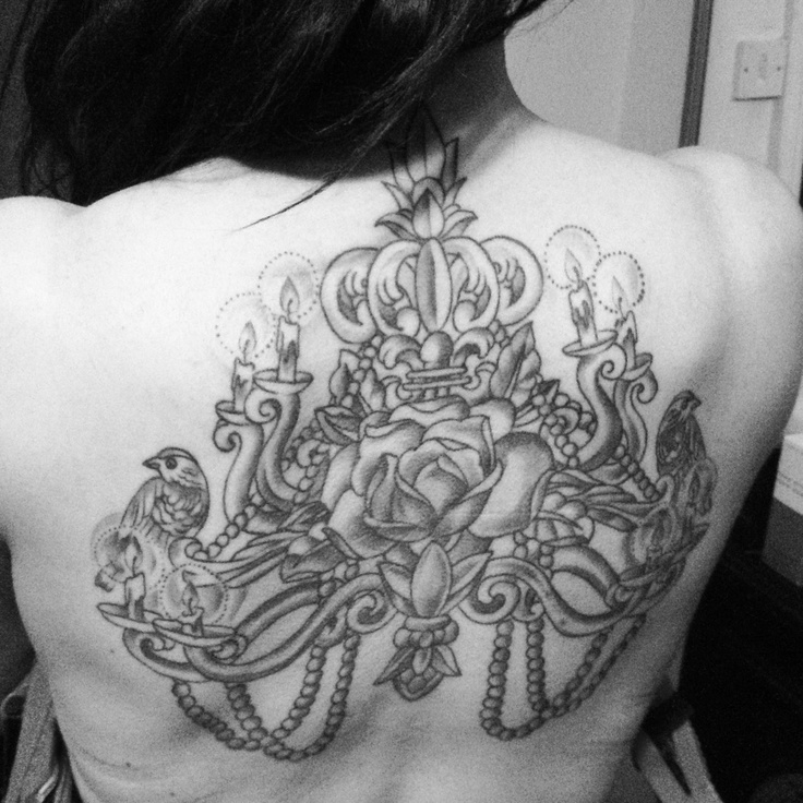 Large chandelier back tattoo