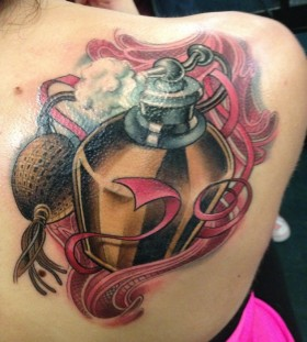Large perfume bottle back tattoo