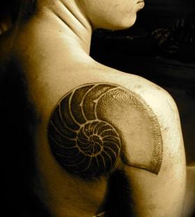 Large shell back tattoo