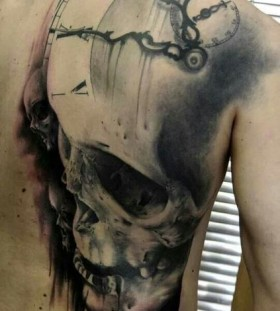 Large skull clock back tattoo