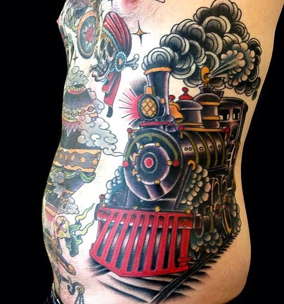 Large steaming train side tattoo