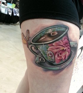 Large teacup leg tattoo