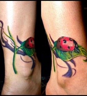 Laybug on a leaf ankle tattoo