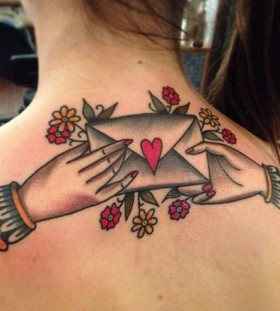 Letter and flowers back tattoo by Nick Oaks