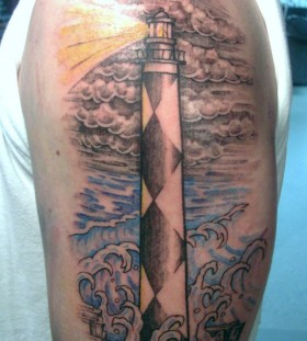 Lighthouse and clouds tattoo