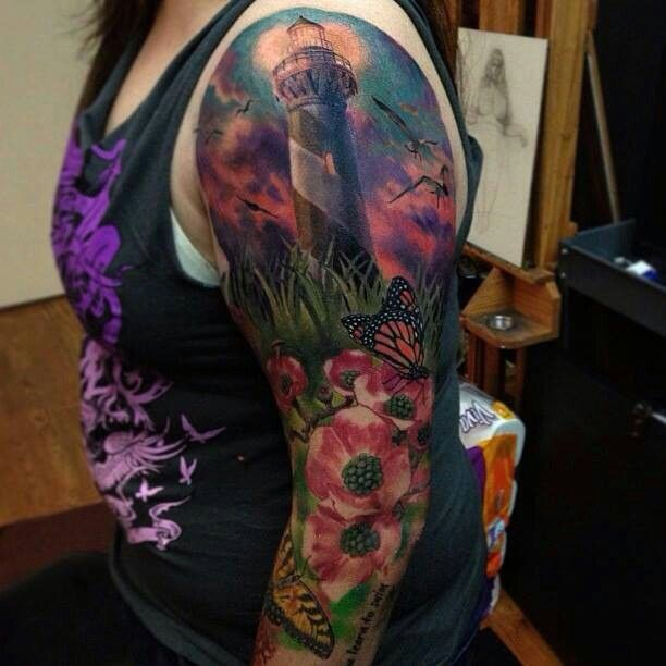 Lighthouse and flowers full arm tattoo