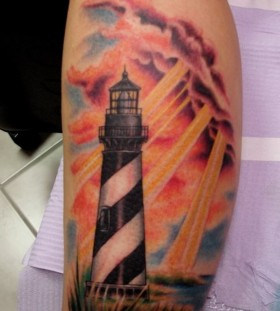 Lighthouse and sunshine tattoo