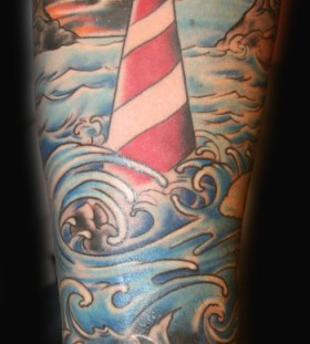 Lighthouse and waves tattoo
