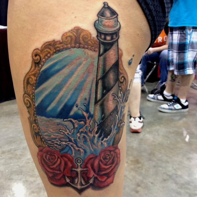Lighthouse frame and roses tattoo