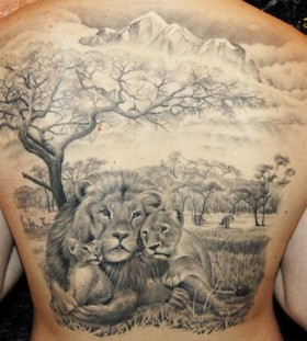 Lion family back tattoo by James Tattooart