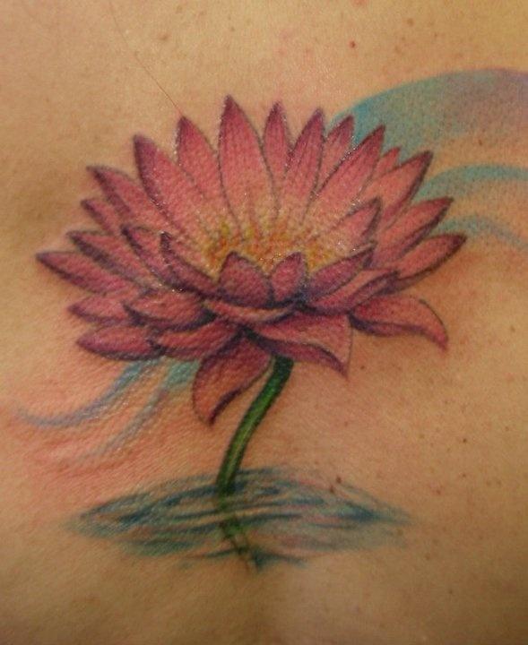 Lotus flower tattoo by Jessica Brennan