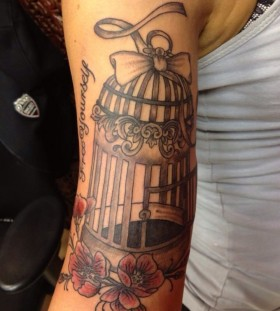 Lovely birdcage arm tattoo