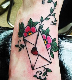 Lovely envelope and flowers foot tattoo