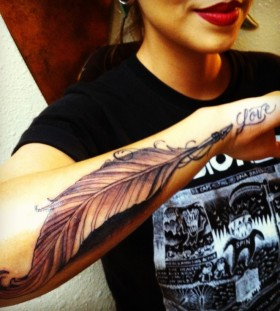 Lovely feather pen tattoo