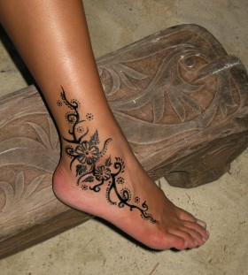 Lovely flower ankle tattoo