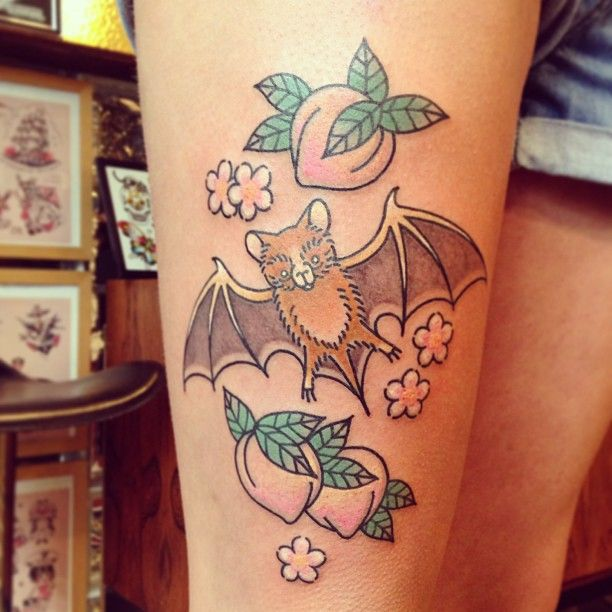 Lovely flowers and fruit tattoo